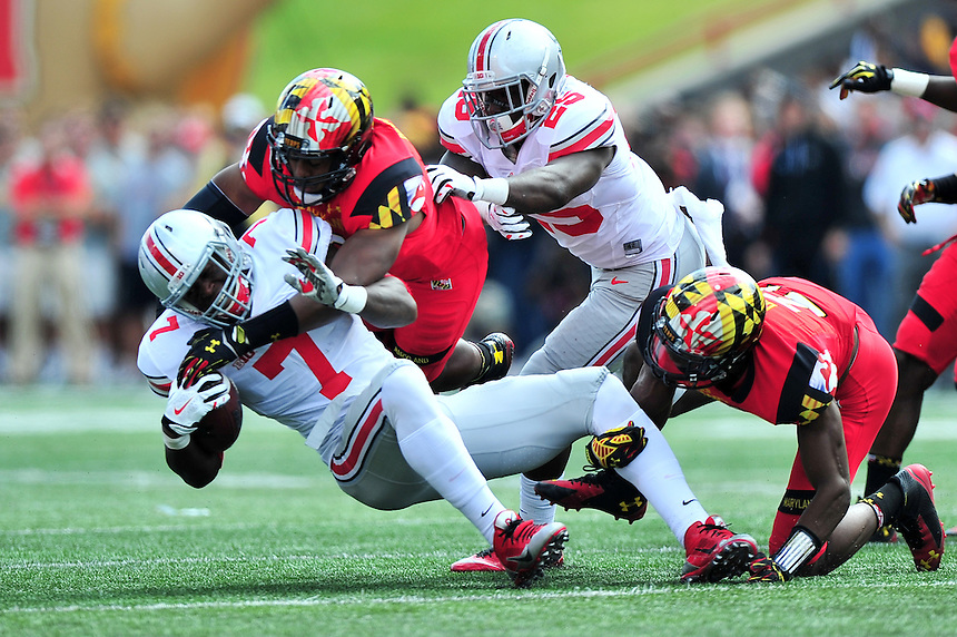 Rod Smith of the Buckeyes is brought down by the Terrapins' defense. Ohio State trounced Maryland 52-24 during a game at the Capital One Field in Byrd Stadium, College Park, MD on Saturday, October 3, 2014.  Alan P. Santos/DC Sports Box