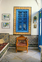 "Tunisia, Sidi Bou Said.  Reception Room of Dar Annabi, a Private Home open for Public Viewing.  Originally constructed 18th. century, remodeled 20th. century.  Inner reception rooms are reserved for family and close friends.  Yellow, black, and white ""lion's paw"" tiles around the window."