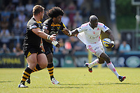 Djibril Camara of Stade Francais is tackled by Ashley Johnson of London Wasps during the first leg of the European Rugby Champions Cup play-off match between London Wasps and Stade Francais at Adams Park on Sunday 18th May 2014 (Photo by Rob Munro)
