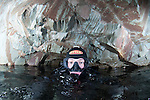 A diver surfaces in the air space in chamber 3 of the hodge close mine system.