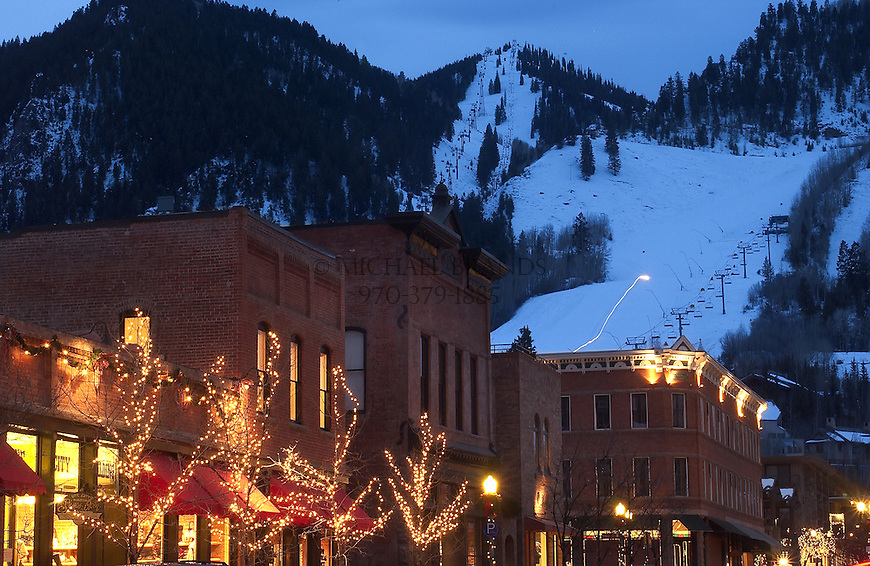 Downtown Aspen at dusk with Aspen Mountain ski area in the background.© Michael Brands. 970-379-1885.
