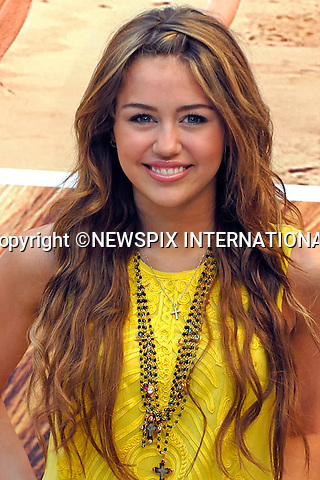 "MILEY CYRUS.at the photocall for ""Hannah Montana: The Movie"", Madrid_21/04/2009.Mandatory Credit Photo: ©NEWSPIX INTERNATIONAL..**ALL FEES PAYABLE TO: ""NEWSPIX INTERNATIONAL""**..IMMEDIATE CONFIRMATION OF USAGE REQUIRED:.Newspix International, 31 Chinnery Hill, Bishop's Stortford, ENGLAND CM23 3PS.Tel:+441279 324672  ; Fax: +441279656877.Mobile:  07775681153.e-mail: info@newspixinternational.co.uk"