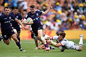 January 27th, Hamilton, New Zealand;  Scotland's Max McFarland tries to runs past the USA defenders during the Day 2 of the HSBC World Rugby Sevens Series 2019, FMG Stadium Waikato,Hamilton, Sunday 27th January 2019.