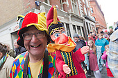 Covent Garden, London, UK. 11 May 2014. The festival starts with a procession around the streets of Covent Garden. A puppeteer with a Mr Punch puppet. The Covent Garden May Fayre and Puppet Festival takes place at St Paul's Church.