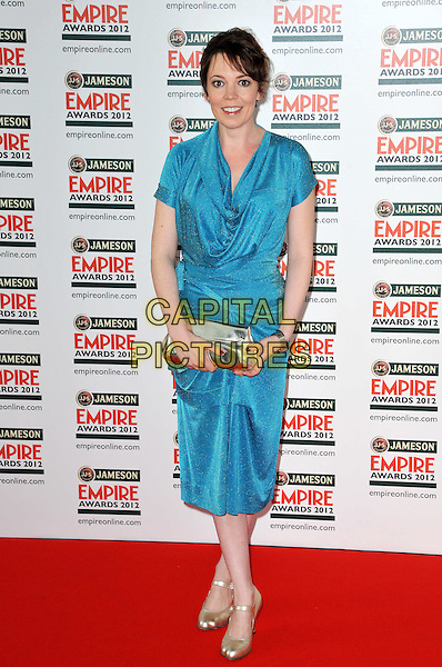 Olivia Colman.Jameson Empire Film Awards at the Grosvenor House Hotel, Park Lane, London, England..March 25th 2012.full length blue dress cowl neck silver clutch bag.CAP/BF.©Bob Fidgeon/Capital Pictures.
