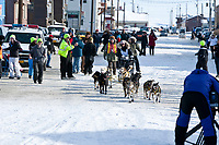 Second-place finisher Hans Gatt runs down Front street into the finish chute in Nome Alaska