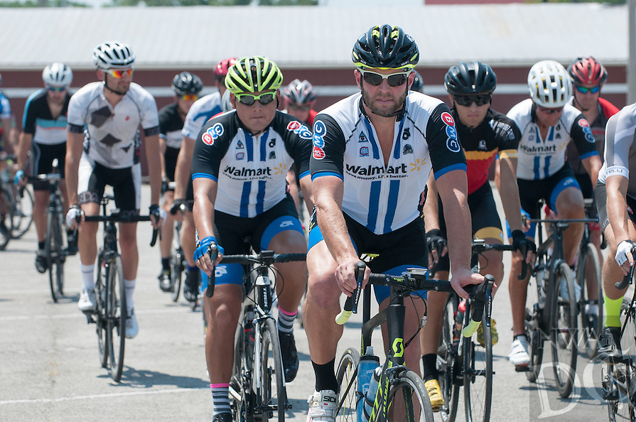 NWA Democrat-Gazette/J.T. WAMPLER  Cyclists start in downtown Rogers for the Walnut Valley Road Race Sunday July 24, 2016. The race, in its second year, is a USA Cycling sanctioned road race held in the Walnut Valley area outside of northeast Rogers and ending in Avoca. There were categories for elite and intermediate skilled men and women, with prizes awarded to the top finishers.