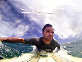 INDONESIA, Mentawai Islands, Kandui Resort, surfer paddles into a wave, Nupussy