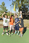Freeport, New York, U.S. September 6, 2013. L-R, RYAN MACOLINO, 8; NATE MACOLINO, 8; DANNY TIMONEY, 8; and KEVIN MURRAY, 9, all from Bellmore, play miniature golf at Crow's Nest Mini Golf in the Nautical Mile.