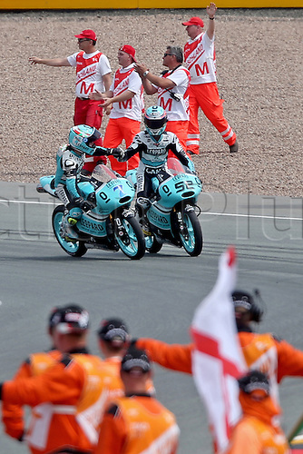 12.07.2015. Sachsenring, Germany MotoGP.  Moto3 Gopro Motorrad Grand Prix Germany.  Spanish Moto3 rider Efren Vazques (l) congratulates his teammate, British Moto3 rider Danny Kent of Leopard Racing, on the first place at the Motorcycle World Championship Grand Prix of Germany at the Sachsenring racing circuit in Hohenstein-Ernstthal, Germany, 12 July.