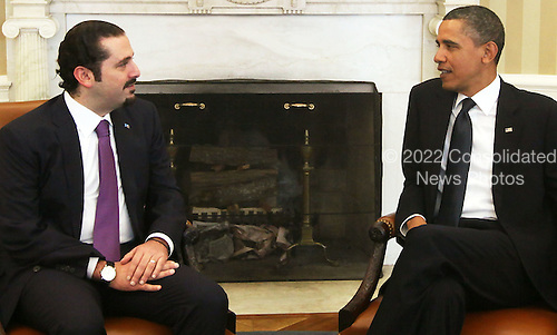 """United States President Barack Obama (R) meets with Prime Minister Saad Hariri (L) of Lebanon in the Oval Office of the White House Wednesday, January 12, 2011 in Washington, DC.  According to a White House media release, the two leaders met """"to discuss U.S. support for Lebanonís sovereignty, independence, and stability, the ongoing work of the Special Tribunal for Lebanon, and other regional issues."""" .Credit: Alex Wong / Pool via CNP.Credit: Alex Wong / Pool via CNP"""