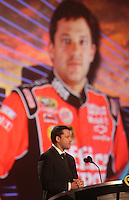 2011 NASCAR Champion Tony Stewart speaks at the NASCAR Championship Banquet, Las Vegas, NV, December 2, 2011.  (Photo by Brian Cleary/www.bcpix.com)