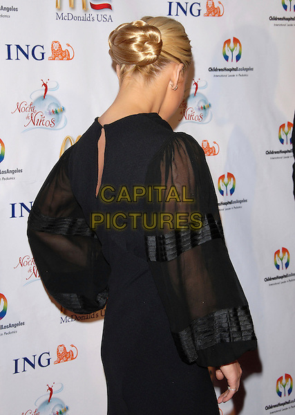 JESSICA SIMPSON.attends Noche de Ninos Gala benefiting Children's Hospital of Los Angeles held at The Beverly Hilton Hotel, .Beverly Hills, California, USA, October 7th 2006. .half length black dress hand on hip peep hole sheer sleeves back behind hair rear.Ref: DVS.www.capitalpictures.com.sales@capitalpictures.com.©Debbie VanStory/Capital Pictures