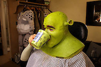"Brian d'Arcy James takes a sip towards the end of the process making him the title charachter in ""Shrek the Musical"".  The hour and a half nightly routine is an orgy of foam latex, silicon and the special color designed by make-up designer Naomi Donne and prosthetic designer Michael Marino.  The new musical is based on the story and characters from William Steig's book ""Shrek!"", as well as the DreamWorks animation film.  The Broadway Theatre, 1681 Broadway, NYC.  Newsday/Ari Mintz  12/5/2008."