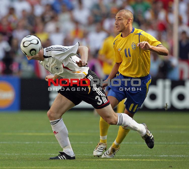 FIFA WM 2006 -  Round of Sixteen - / Viertelfinale <br /> Play    #49 (24-Jun) - Deutschland - Schweden<br /> <br /> zwekampf Arne Friedrich und Henrik Larsson<br /> <br /> <br /> Foto &copy; nordphoto