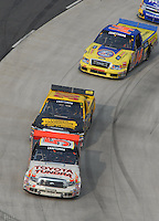 Mar 31, 2007; Martinsville, VA, USA; Nascar Craftsman Truck Series driver Mike Skinner (5) leads Todd Bodine (30) and Rick Crawford (14) during the Kroger 250 at Martinsville Speedway. Mandatory Credit: Mark J. Rebilas