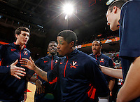 Virginia guard Jontel Evans (1) goes through the huddle before the game against Maryland Sunday in Charlottesville, VA. Photo/Andrew Shurtleff