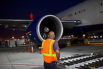 Michael Gaston readies to unload cargo from a Delta 777 flight that recently arrived from Johannesburg, South Africa at Gate F8 outside of the Maynard H. Jackson Jr. International Terminal at Hartsfield–Jackson Atlanta International Airport, in Atlanta, Georgia on August 28, 2013.