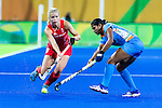 Sophie Bray #19 of Great Britain passes the ball during India vs Great Britain in a Pool B game at the Rio 2016 Olympics at the Olympic Hockey Centre in Rio de Janeiro, Brazil.