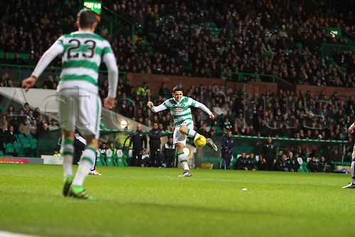 02.03.2016. Celtic Park, Glasgow, Scotland. Scottish Premier League. Celtic versus Dundee.Tom Rogic hits a volley watched by team mate Lustig