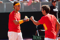 Rafael Nadal and Marc Lopez during the qualification couple game for the Davis Cup in Caja Magica, Madrid. September 14, 2013. (ALTERPHOTOS/Victor Blanco)