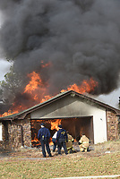 NWA Democrat-Gazette/FLIP PUTTHOFF <br /> TRAINING BURN<br /> Rogers firefighters stand by a controlled burn Tuesday Feb. 5 2019 of a house on Pleasant Grove Road near Interstate 49. Rogers Fire Department burned two adjacent houses after using them for training purposes. Firefighters from area fire departments and other agencies trained for several days in the two houses before they were ignited, said Capt. Dennis Thurman with the Rogers Fire Department.