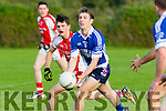 Tom Kennelly, Shannon Rangers, gets his pass away despite being policed by Rathmore's Cathal Murphy