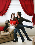 Colorado Ballet dancer Caitlin Valentine was born on Valentine's day.  She and her fiance, Christopher Ellis, also a Colorado ballet dancer, and their dog, Franklin, pose for a portrait in their condominium in southeast Denver. (ELLEN JASKOL/ROCKY MOUNTAIN NEWS)