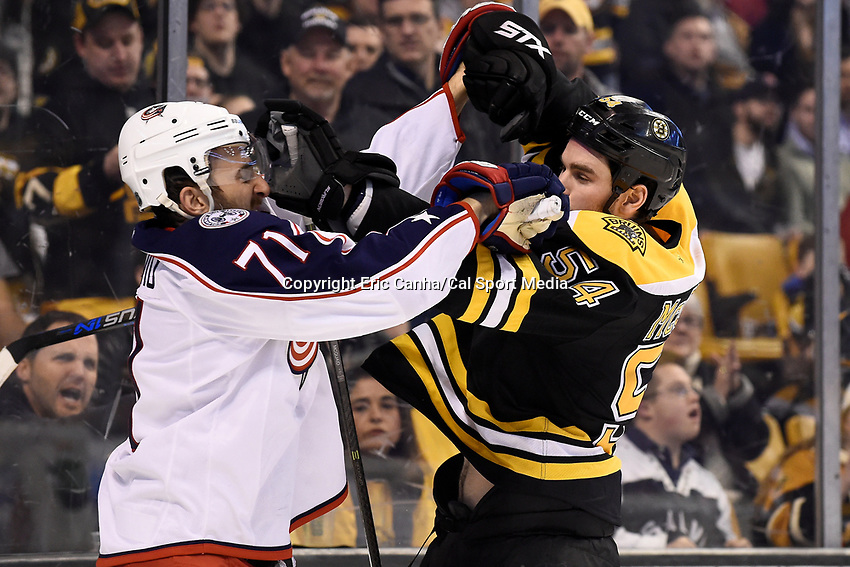 Monday, February 22, 2016: Boston Bruins defenseman Adam McQuaid (54) and Columbus Blue Jackets left wing Nick Foligno (71) throw punches during the National Hockey League game between the Columbus Blue Jackets and the Boston Bruins, held at TD Garden, in Boston, Massachusetts. The Blue Jackets defeat the Bruins 6-4. Eric Canha/CSM