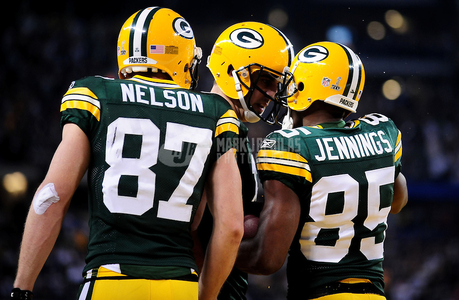 Feb 6, 2011; Arlington, TX, USA; Green Bay Packers quarterback Aaron Rodgers (12) celebrates with wide receiver Jordy Nelson (87) and wide receiver Greg Jennings (85) after Jennings scored a touchdown during the first half of Super Bowl XLV against the Pittsburgh Steelers at Cowboys Stadium.  Mandatory Credit: Mark J. Rebilas-
