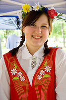 Happy teen wearing garland and costume of Sweden. Svenskarnas Dag Swedish Heritage Day Minnehaha Park Minneapolis Minnesota USA