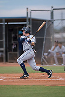AZL Padres 1 left fielder Greg Lambert (14) follows through on his swing during an Arizona League game against the AZL Padres 2 at Peoria Sports Complex on July 14, 2018 in Peoria, Arizona. The AZL Padres 1 defeated the AZL Padres 2 4-0. (Zachary Lucy/Four Seam Images)