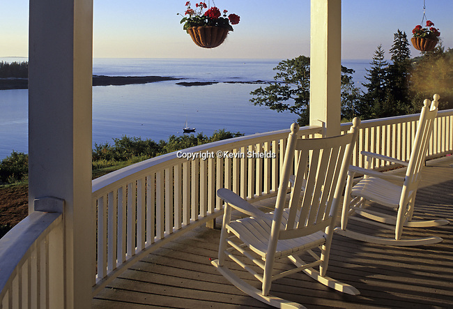 Rocking chairs on a porch in Georgetown, Maine, USA, overlooking the Atlantic Ocean.