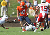 Virginia tight end Jake McGee (83) fumbles the ball next to Ball State  defenders during the football game Saturday Oct. 5, 2013 at Scott Stadium in Charlottesville, VA. Ball State defeated Virginia 48-27. Photo/The Daily Progress/Andrew Shurtleff