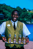 Butler Trevor St. Rose serving Piton beers, Sandals Regency  Resort, St. Lucia