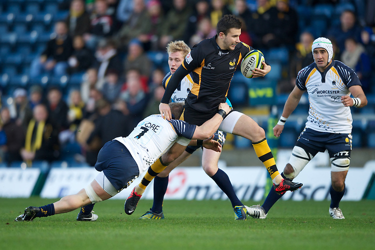 Tommy Bell of London Wasps is tackled in mid-flight by Jake Abbott of Worcester Warriors during the LV= Cup second round match between London Wasps and Worcester Warriors at Adams Park on Sunday 18th November 2012 (Photo by Rob Munro)