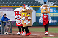 Mascots for Scooter's Coffee race around the warning track during a Pacific Coast League game between the Omaha Storm Chasers and the Memphis Redbirds on April 26, 2019 at Werner Park in Omaha, Nebraska. Memphis defeated Omaha 7-3. (Zachary Lucy/Four Seam Images)