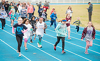 NWA Democrat-Gazette/BEN GOFF @NWABENGOFF<br /> Children lead off on the first lap Saturday, April 21, 2018, during the Northwest Arkansas Kiwanis Clubs Fun Walk benefiting Arkansas Children's Northwest at the track at Springdale Har-Ber High. Thirteen Kiwanis clubs from Benton, Washington and Madison counties joined forces for the annual fundraiser.