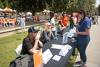 Occidental College staff offer information about Athletics as part of the Community Resource Fair for admitted students and their parents on the Occidental College campus during Experience Oxy! Admitted Student Day, April 18, 2014. (Photo by Marc Campos, Occidental College Photographer)