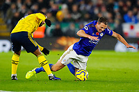 9th November 2019; King Power Stadium, Leicester, Midlands, England; English Premier League Football, Leicester City versus Arsenal; Jonny Evans of Leicester City is tripped by Pierre-Emerick Aubameyang of Arsenal - Strictly Editorial Use Only. No use with unauthorized audio, video, data, fixture lists, club/league logos or 'live' services. Online in-match use limited to 120 images, no video emulation. No use in betting, games or single club/league/player publications