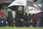 Padraig Harrington shelters while he waits to putt on the 3rd green during the final round of the Irish Open on 20th of May 2007 at the Adare Manor Hotel & Golf Resort, Co. Limerick, Ireland. (Photo by Eoin Clarke/NEWSFILE)