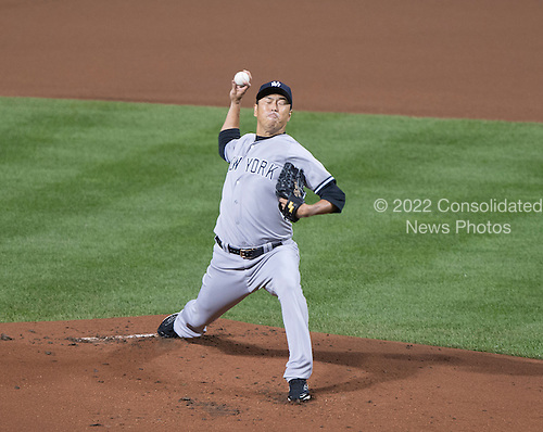 New York Yankees pitcher Hiroki Kuroda (18) works in the first inning against the Baltimore Orioles at Oriole Park at Camden Yards in Baltimore, MD on Sunday, September 14, 2014.  <br /> Credit: Ron Sachs / CNP<br /> (RESTRICTION: NO New York or New Jersey Newspapers or newspapers within a 75 mile radius of New York City)
