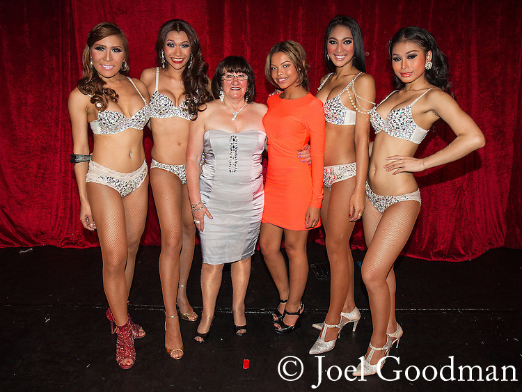 """© Joel Goodman - 07973 332324 . 26/06/2013 . Manchester , UK . Shameless actresses Alice Barry (3rd from left) and Kira Martin (3rd from right) pose with the Ladyboys during the interval . The Ladyboys of Bangkok perform their show , """" Glamorous Amorous """" at the Sabai Pavilion , in Manchester , as part of their 2013 UK tour . Photo credit : Joel Goodman"""