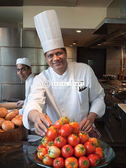 Chef at Hyatt Regency Hotel, Mumbai, with tomatoes.