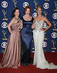 LOS ANGELES, CA. - September 20: Actresses Elizabeth Moss, Christina Hendricks and January Jones pose in the press room at the 61st Primetime Emmy Awards held at the Nokia Theatre on September 20, 2009 in Los Angeles, California.