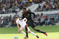 LOS ANGELES, CA - MARCH 01: Mark-Anthony Kaye #14 of LAFC beats an Inter Miami CF defender during a game between Inter Miami CF and Los Angeles FC at Banc of California Stadium on March 01, 2020 in Los Angeles, California.