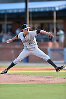Charleston RiverDogs starting pitcher Andrew Beresford #30 delivers a pitch during a game against the Asheville Tourists at McCormick Field July 29, 2014 in Asheville, North Carolina. The RiverDogs defeated the Tourists 9-3. (Tony Farlow/Four Seam Images)