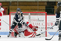 Boston, Massachusetts - February 25, 2017: NCAA Division I. Hockey East (WHEA) Quarterfinal game. Boston University (white) defeated University of New Hampshire (blue), 4-3, at Walter Brown Arena.