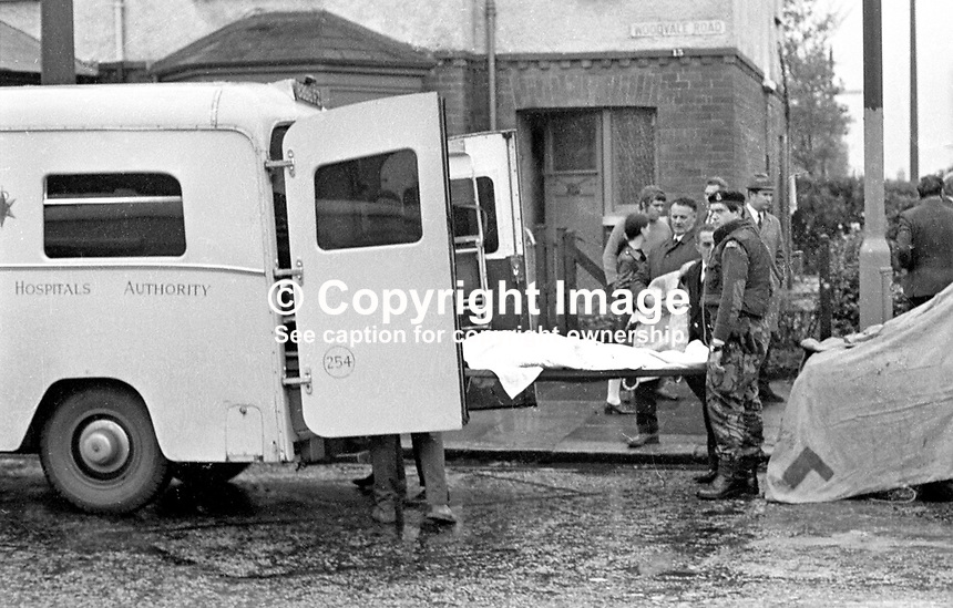 The bodies of Constables Cecil Cunningham &amp; John Haslett who were murdered by the Provisional IRA on 15th October 1971, are transferred to an ambulance. The two officers were on surveillance duty keeping watch on a savings bank and post office at the junction of Twadell Avenue and the Woodvale Road, Belfast, N Ireland, when the shooting occured.  197110150398c.<br /> <br /> Copyright Image from Victor Patterson, 54 Dorchester Park, Belfast, UK, BT9 6RJ<br /> <br /> t1: +44 28 9066 1296 (from Rep of Ireland 048 9066 1296)<br /> t2: +44 28 9002 2446 (from Rep of Ireland 048 9002 2446)<br /> m: +44 7802 353836<br /> <br /> e1: victorpatterson@me.com<br /> e2: victorpatterson@gmail.com<br /> <br /> The use of my copyright images is subject to my Terms &amp; Conditions.<br /> <br /> It is IMPORTANT that you familiarise yourself with them. They are available on my website at www.victorpatterson.com.<br /> <br /> None of my copyright images may be used on a website unless they are visibly watermarked, i.e. &copy; Victor Patterson within the body of the visible image. Metadata denoting my copyright must NOT be deleted. <br /> <br /> Web use is extra at currently recommended NUJ rates.