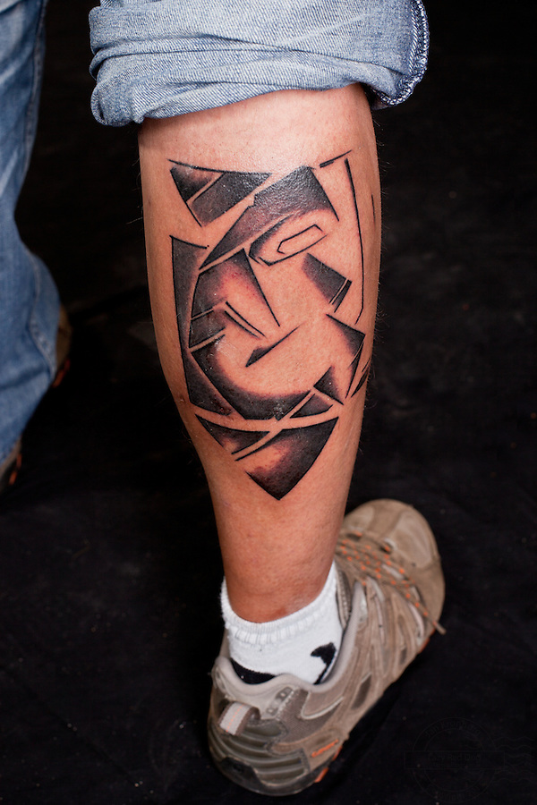German man with abstract, nonfigurativ, tattoo on lower right leg.<br />
